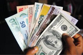 Dollars-n-Nigeria-Naira-cash-797287